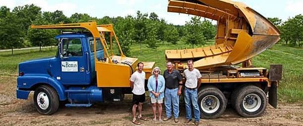 Bemis family standing in front of tree space truck: Nathan, Donna, Tracey and Jeremy Bemis